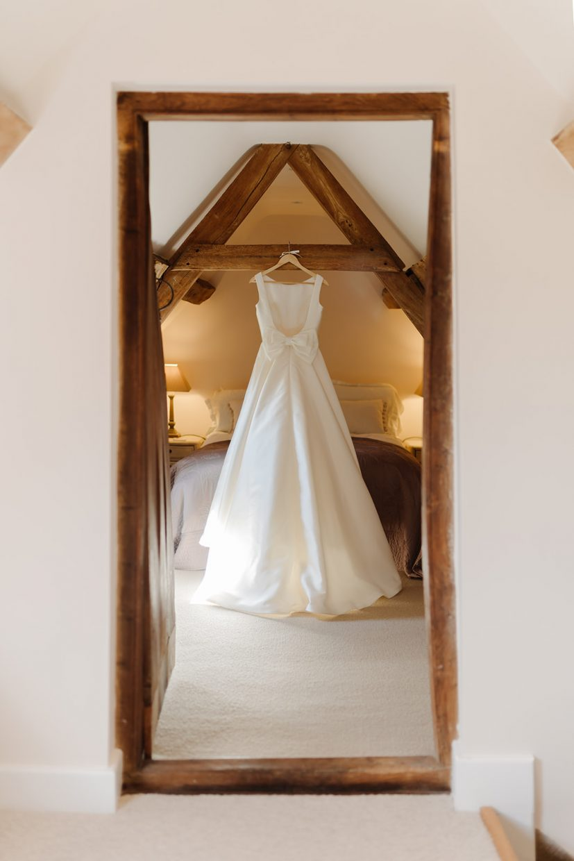 wedding dress hanging from beam at primrose hill farm