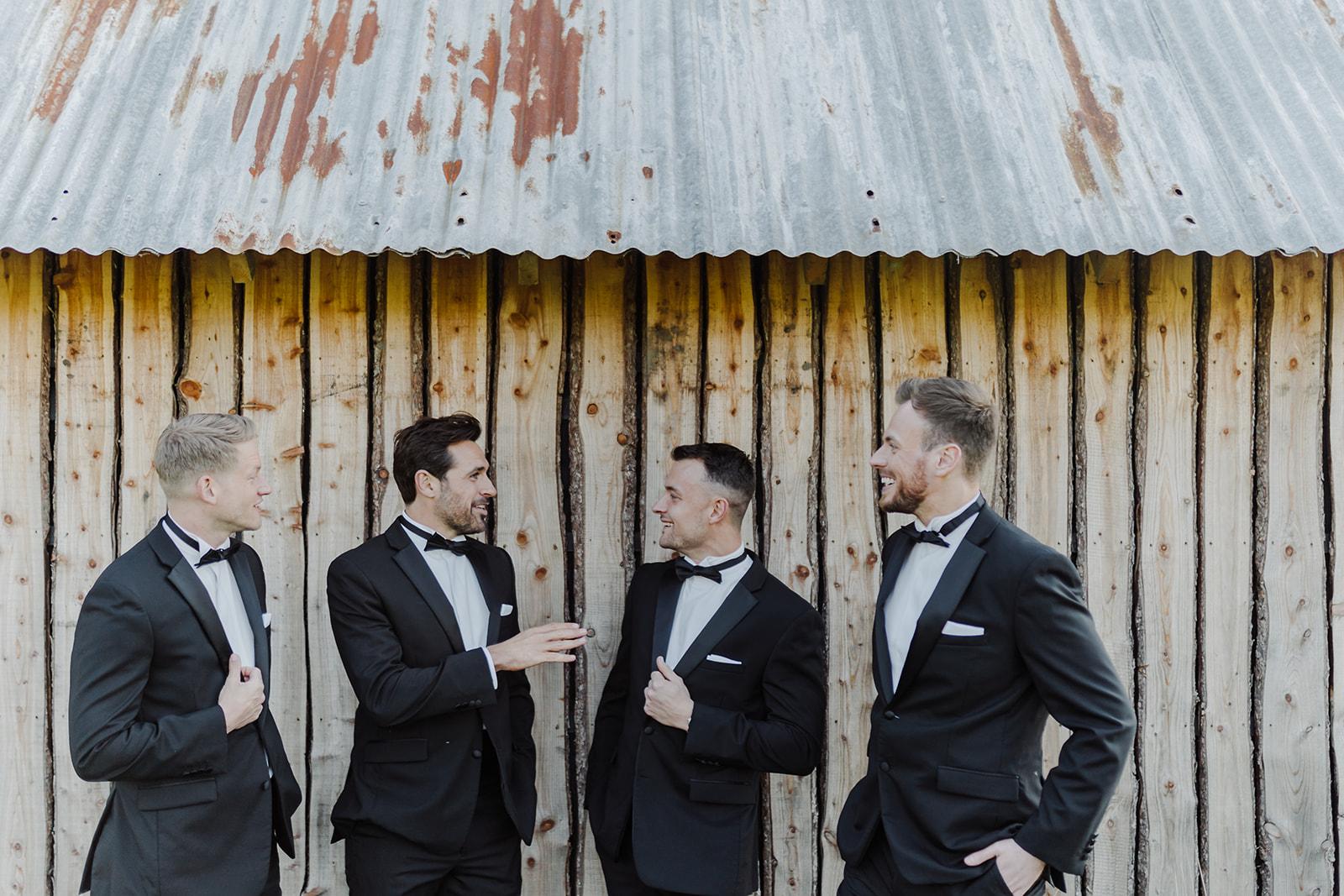 boho couples destination wedding groomsmen black tie