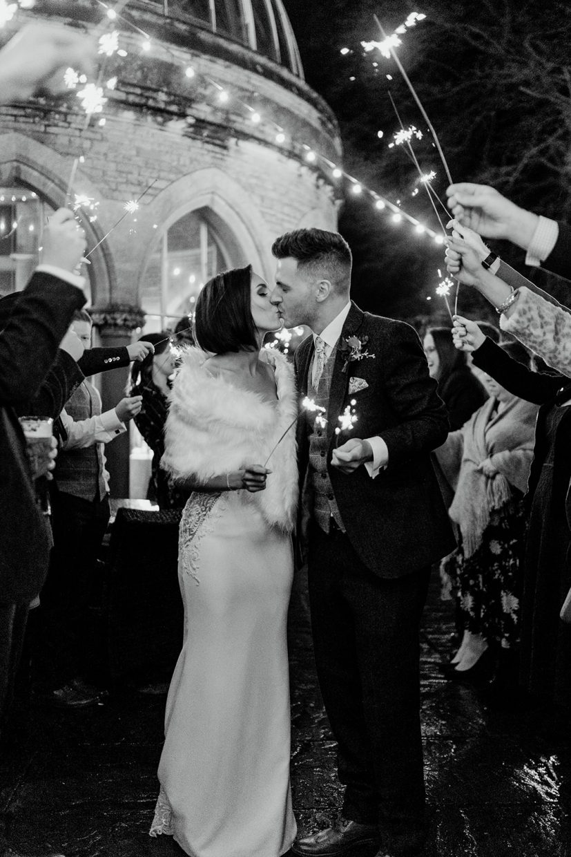 bride and groom sparkler exit at tortworth court