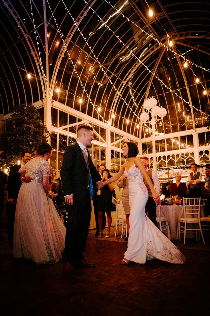 bride and groom first dance in orangery at tortworth court