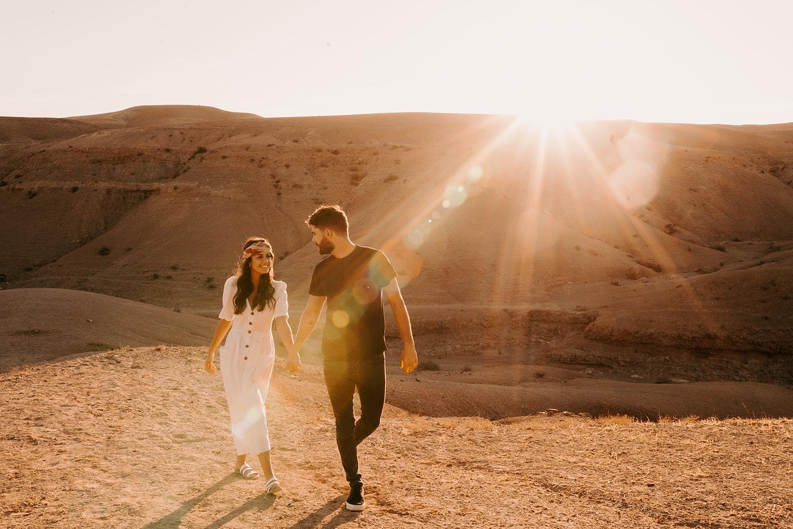 couples engagement shoot in agafay desert at golden hour marrakech