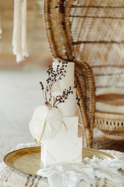 destination boho wedding cake with dried wild flowers