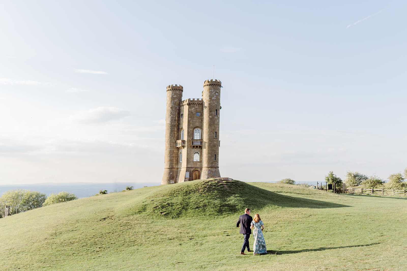 couple walking engagement shoot broadway tower cotswolds