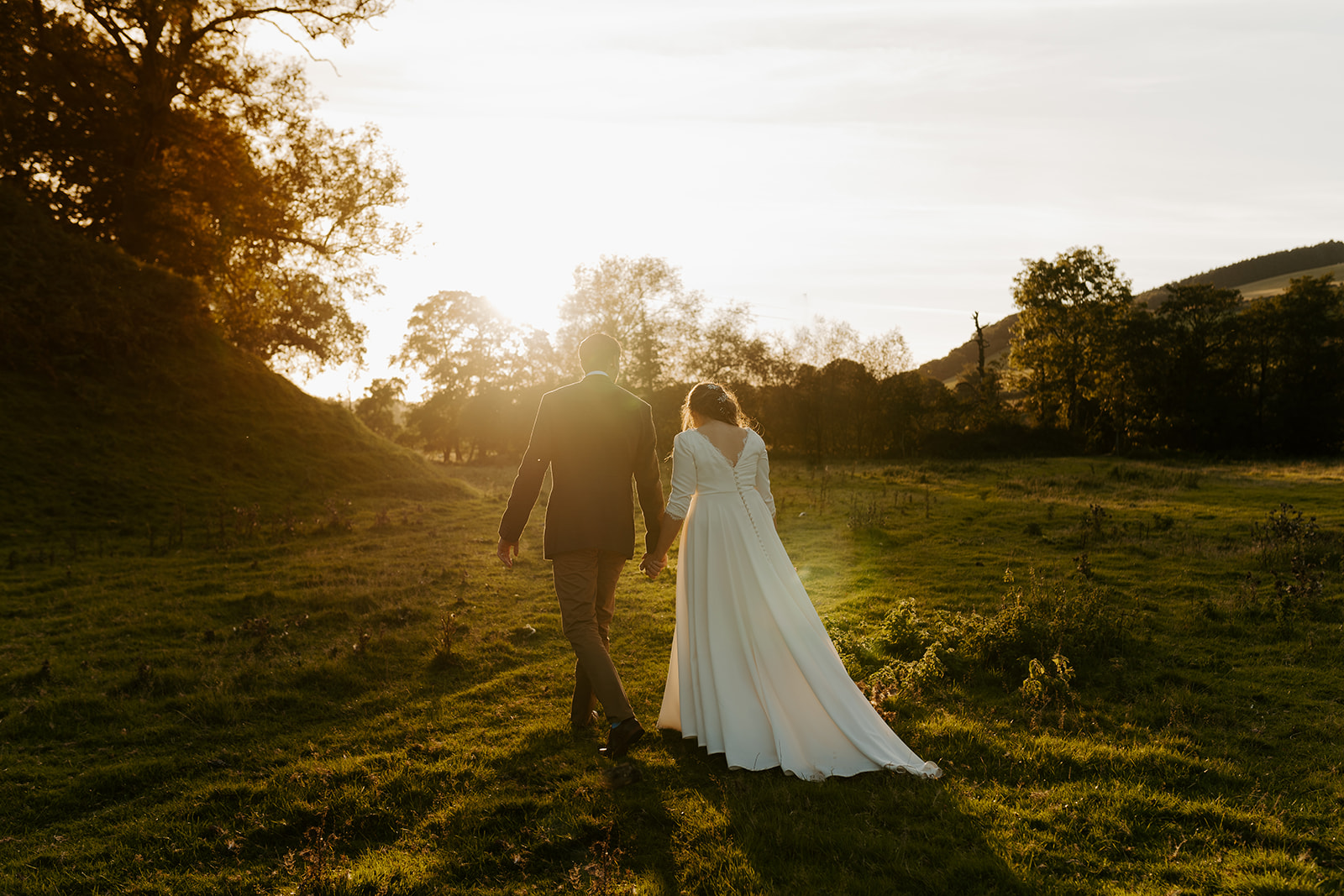 golden hour couples portraits at boho wild wedding in wales wilde lodge