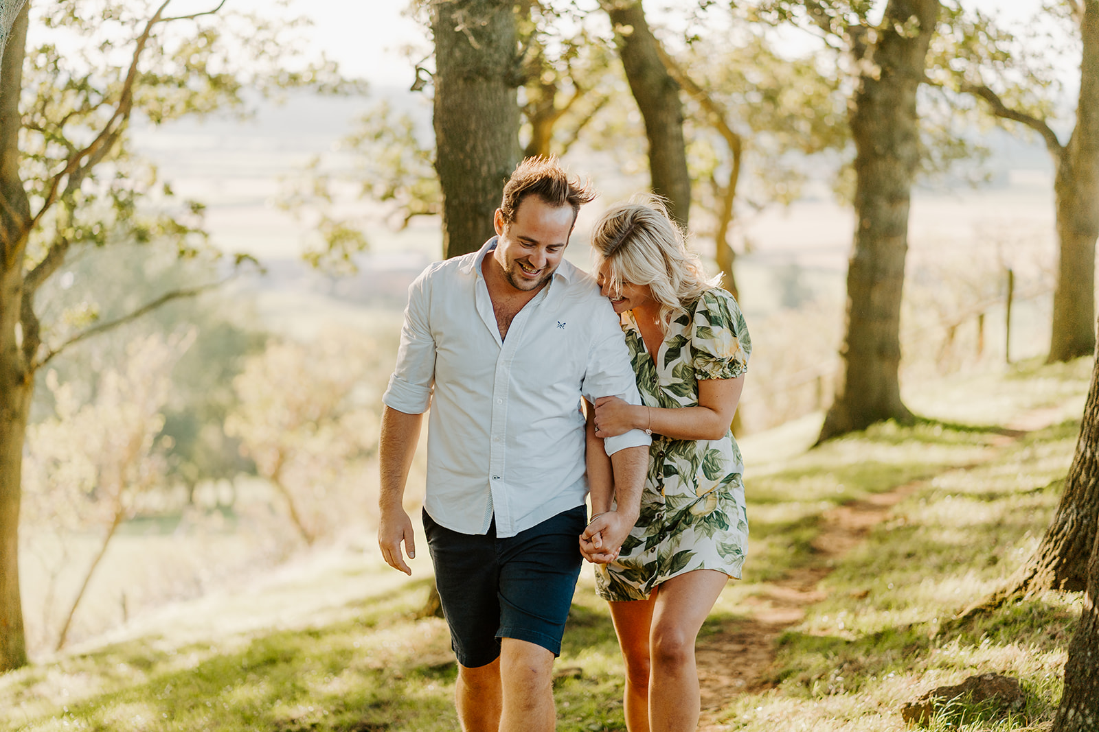 Couples engagement shoot at golden hour in wheat grass fields