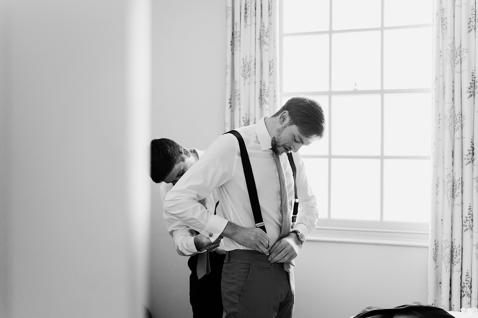 groom preparations wedding photos wales