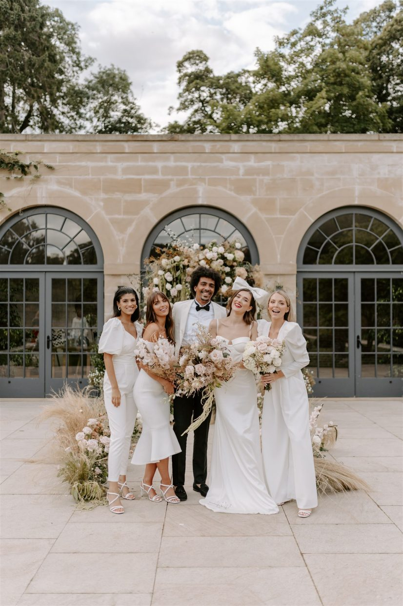 Isla-and-Smith-wedding-photography-bridesmaids-ceremony-floral-arch-at-middleton-lodge-estate